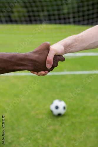Close up of soccer player doing handshake