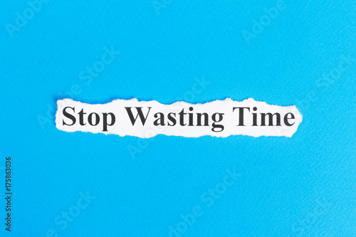 Stop Wasting Time text on paper Poster