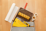 Tools for gluing wallpapers on the laminate floor. A room after renovation. Fresh repair in a room. - 175865236