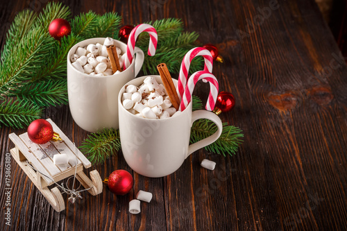 Fotobehang Chocolade Two cups with small marshmallows on a dark wooden background