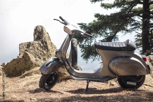Foto op Aluminium Scooter scooter vespa parked in the mountains