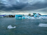 a heap of icebergs of different sizes, close to the coast. - 175868081