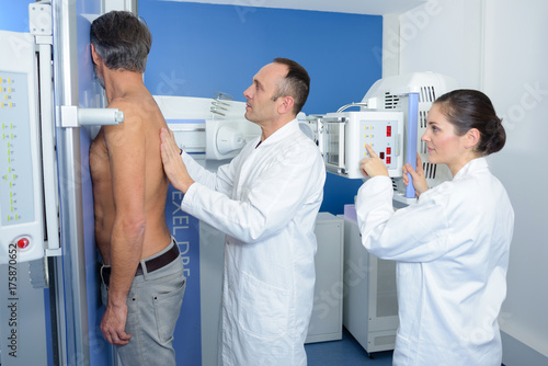 Doctor guiding patient for xray