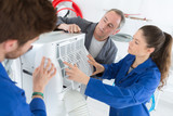 air conditioning repairman teaching students how to work