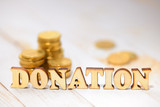 Wood word donate - 175873645