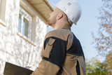 confident young builder outdoors - 175873853