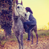 horsewoman with his horse in the countryside - 175875806