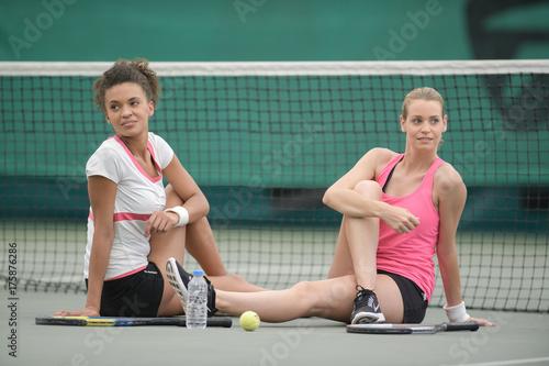 Fotobehang Tennis stretching female tennis players warming up