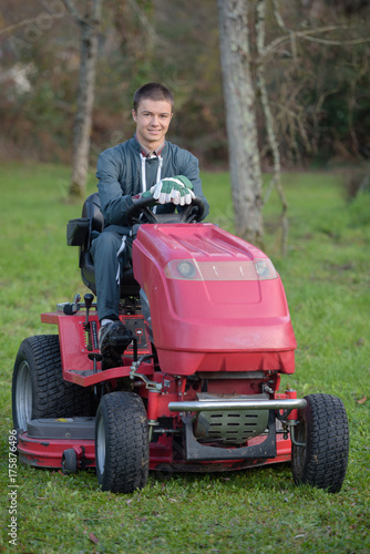 Plakat Portrait of man driving mower
