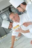 confectioner apprentice in kitchen