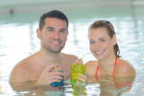 the couple relaxing in the pool during honey moon period - 175882846