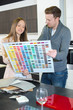 Couple looking at large color chart