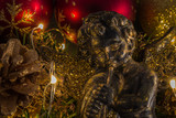 Christmas angel on abstract blurry background and golden lights, fir cone and red Christmas balls - 175892844