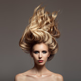 Portrait of blonde woman. Hair storm on her head. - 175895023