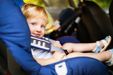 Little boy sitting in the car seat in the car. - 175903042