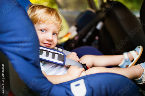 Deurstickers Wanddecoratie met eigen foto Little boy sitting in the car seat in the car.