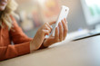 closeup of woman's hand using smartphone