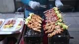 Footage of Local seller make roasted chicken and pork barbecue at Udom Suk, Bangkok, Thailand - close up - 175908255