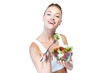 Beautiful young woman eating salad over white background.