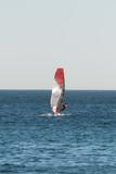 Man windsurfing in the open sea. - 175925845