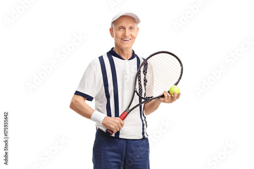 Senior with a racket and a tennis ball