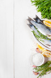 White wooden background with fresh raw fish and ingredients - 175937417