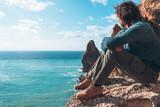 Man traveler over cold sea landscape