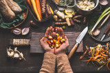 Female woman hands holding diced colorful vegetables on rustic kitchen table with vegetarian cooking ingredients and tools. Healthy and clean food  cooking and eating  concept. - 175944434