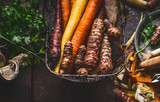Close up of colorful organic root vegetables in harvest basket on dark background, top view. Healthy and clean food and eating  concept. - 175944888