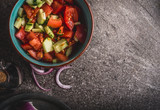 Healthy tomatoes cucumber salad served on gray stone background, top view, close up. Healthy, diet  and clean food and eating  concept. - 175945608