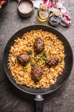 Meat balls and vegetables rice in pan served on gray stone kitchen table background, top view - 175945682