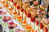 Gourmet appetizers: caviar, venison, tuna and salmon. - 175947436