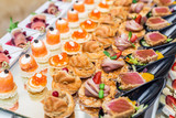 Gourmet appetizers: caviar, venison, tuna and salmon. - 175947461