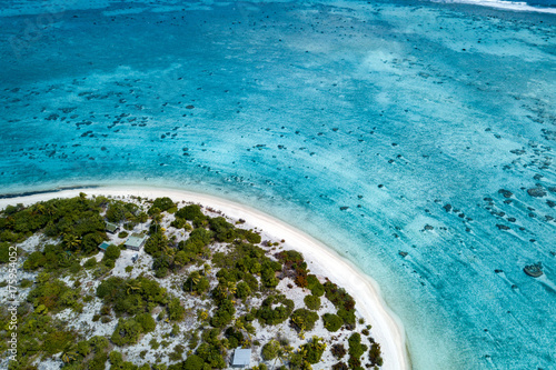 Fotobehang Blauwe jeans aerial view of sandy beach lagoon of polynesia Cook islands