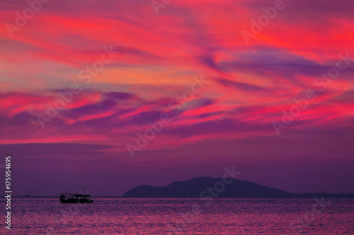 Foto op Canvas Crimson Purple sunset in Sanya, Hainan, China. Colorful madness from the clouds, merging with the sea.