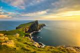Beautiful golden light at sunset at Neist Point Lighthouse on the Isle of Skye, Scotland. - 175958000