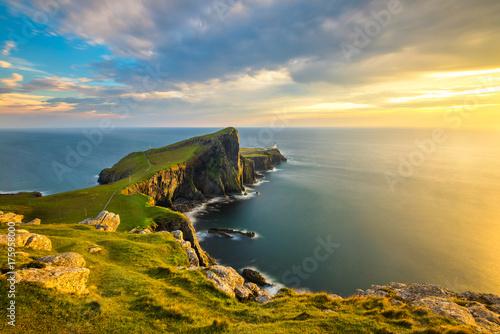 Beautiful golden light at sunset at Neist Point Lighthouse on the Isle of Skye, Scotland.