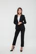 Full length portrait of confident pretty businesswoman