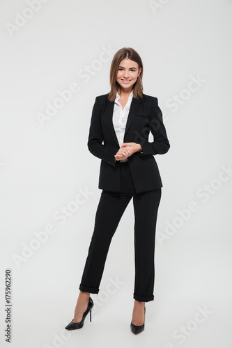 Deurstickers Wanddecoratie met eigen foto Full length portrait of confident pretty businesswoman
