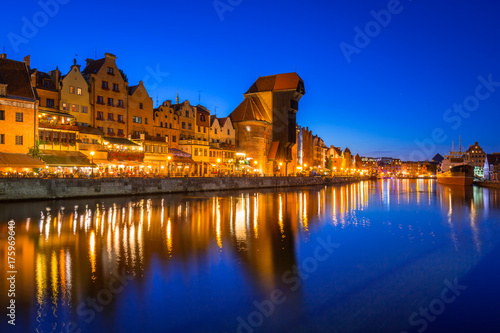 Poster Schip Gdansk at night with historic port crane reflected in Motlawa river, Poland