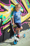 Young boy skateboarding with graffity - 175971610