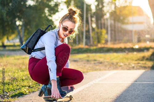 Aluminium Skateboard Fashionable girl with a skateboard in the park