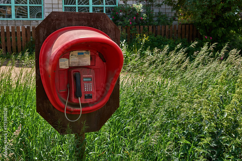 Telephone booth of red color Poster