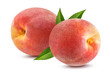Two fresh peaches with leaf isolated on white background with clipping path