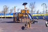 Children's safe wooden playground recreation area at seaside public park - 175988428