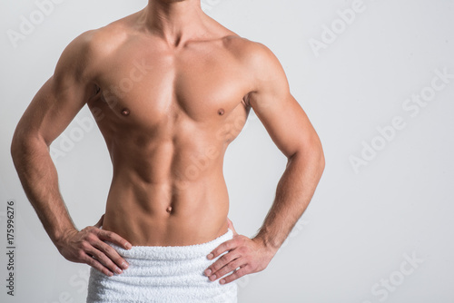 Charming guy is demonstrating perfect torso
