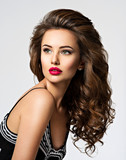 Beautiful woman with long curly hair - 175999493