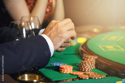Poster Male hands and casino chips