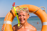 Cheerful woman wearing snorkeling mask - 176014495