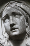 Virgin Mary statue. Vintage sculpture of sad woman (Religion, faith, suffering, love concept) - 176014669